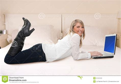 laptop in bed woman using laptop in bed stock photography image 31121072