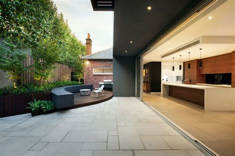 modern patio design natural or manufactured your guide to choosing paving