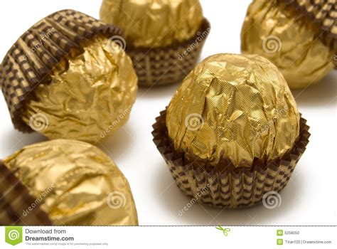 choco gold chocolate candies are in the gold wrapping stock photo