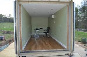 Barn Homes Kits spray foam insulation in a cargo container shipping