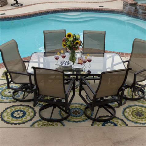 Glass Table Patio Set Acadia 7 Sling Patio Dining Set With Swivel Rockers And Glass Table By Lakeview Outdoor