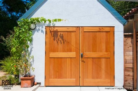 outswing carriage garage doors eclectic garage and
