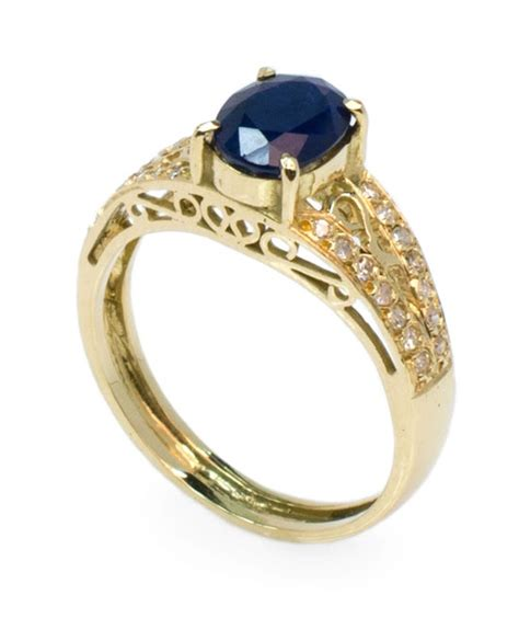 Safira Gold anel em ouro 18k uma safira azul e diamantes ring in 18k gold with a blue sapphire and