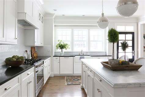 classic white kitchen cabinets honed carrera marble countertops transitional kitchen