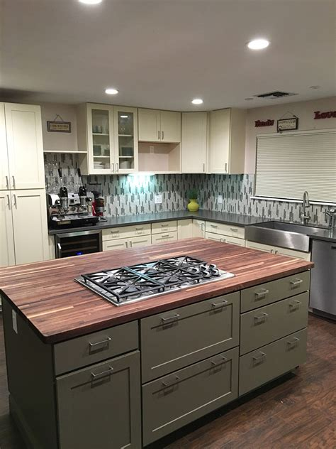 island counter cream green shaker cabinets butcher block island counter