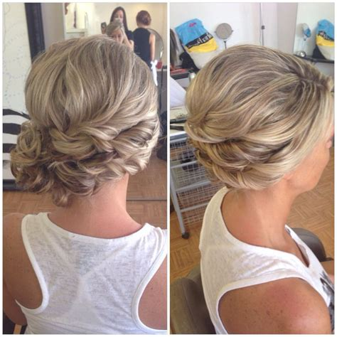 bridal hair wedding hair side bun curly bun side swept updo updo hairstyle