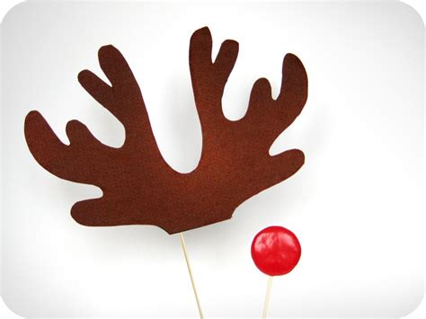 christmas reindeer antlers and red nose on sticks holiday