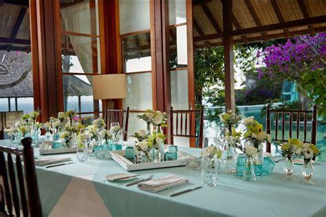 Mukena Bali Roses 7 green cymbidium white lisianthus tuberose and foliage table centerpiece a by tirtha