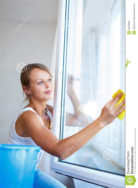 washing house windows pretty young woman doing house work washing windows stock images image 35328864