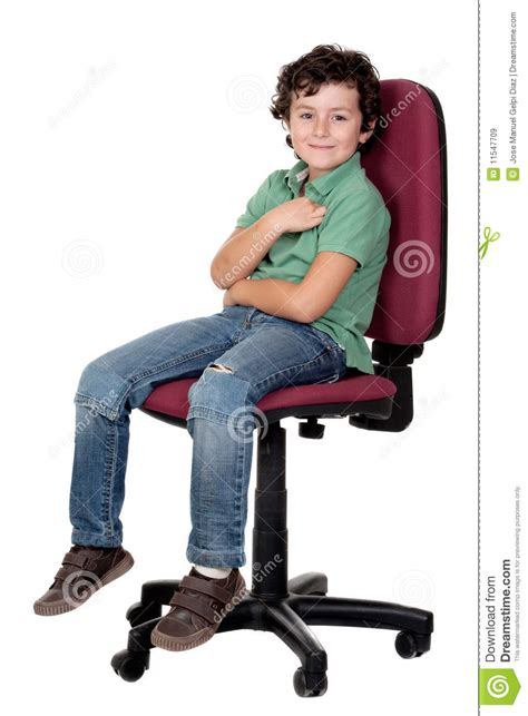 sit on the chair adorable boy sitting on big chair stock image