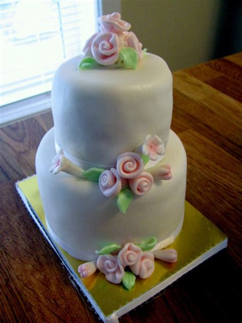 miniature cakes and wedding cake 60 miniature cakes plus a 2 tiered wedding cake cupcakes mini cakes