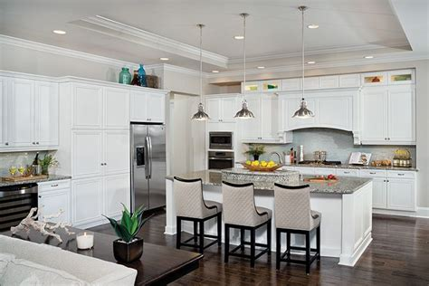 add luxury to your kitchen with river white granite this white kitchen shows the latest in functionality and