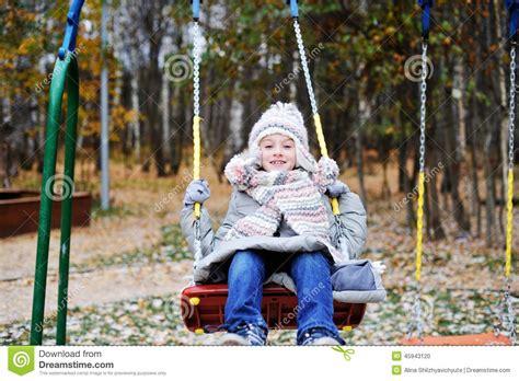 swing girl girlband kid girl on a swing at beautiful winter day stock photo