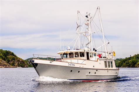 dhoni boat for sale modern sport fishing boat cruising in tropical waters