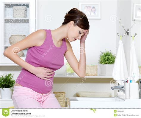 bathroom problems while pregnant pregnant woman with strong pain of stomach stock photos