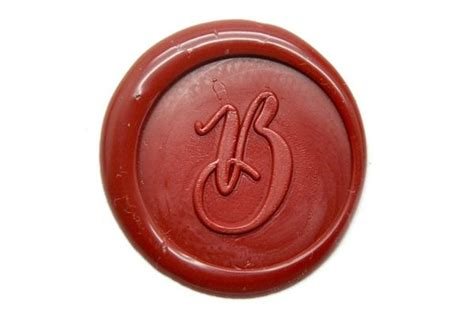 a wax personalized copperplate calligraphy initial wax seal