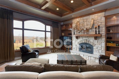 casual living room with brick fireplace and detailed