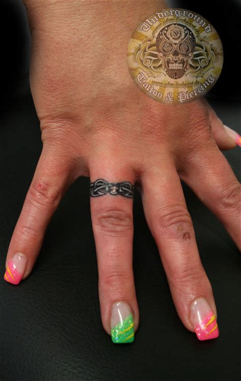 ring finger tattoo for couples 25 beautiful ring finger tattoo designs designcanyon