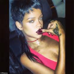 ghetto goth rihanna steps out in plunging red dress
