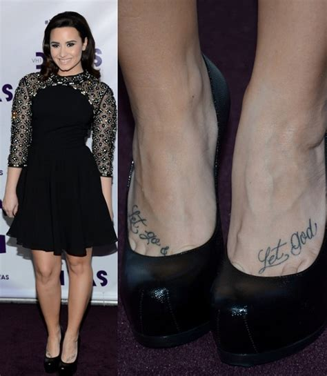 demi lovato s tattoos lettering tattoo on foot pretty