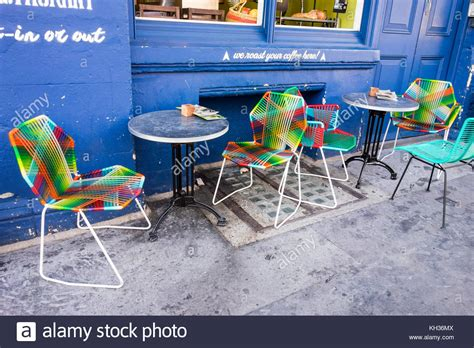 outside cafe table and chairs colourful tables chairs outside cafe stock photos