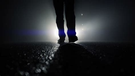 light for walking at night mystical scene of person walking into foggy night