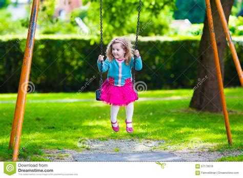 Kids On Playground Swing Stock Photo Image 57179518
