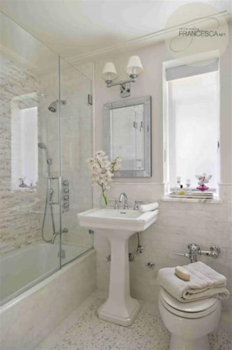 absolutely gorgeous bathroom with glossy white pedestal sink soft gray walls paint color