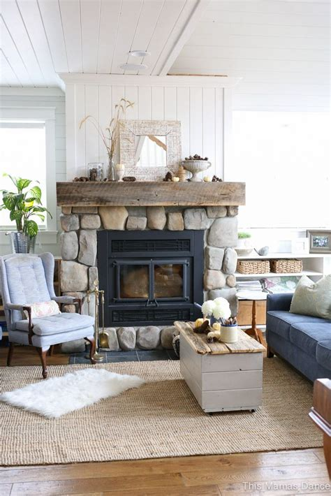 shiplap next to fireplace stone fireplace reclaimed mantle white shiplap cabin