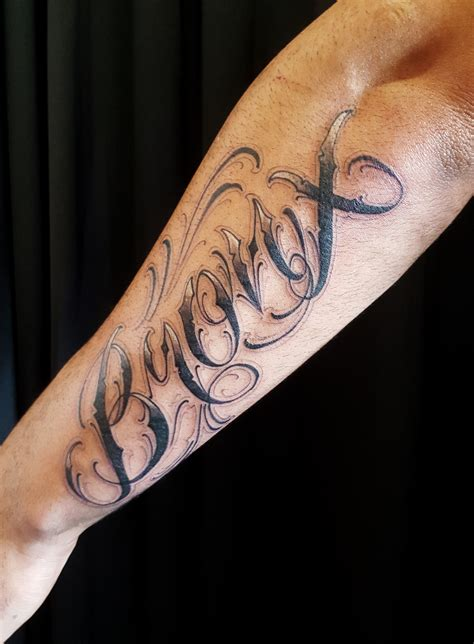 custom lettering bronx on outer forearm tattoo chronic ink