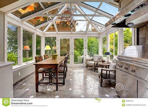 Mil House Plans sunroom patio area with transparent vaulted ceiling stock