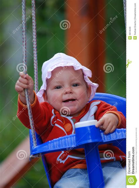babies swinging baby swinging on swing on playground side view royalty