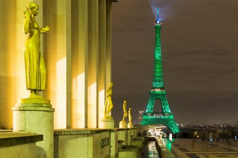 paris monuments light  green  celebrate climate change action