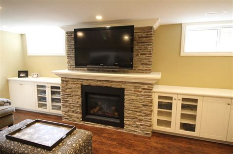 stone with built ins basement recreation room with new stone fireplace and