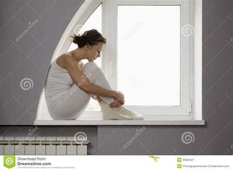 sitting window sad sitting on window sill stock image image of leisure 33862427