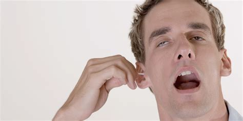 cleaning ears should you clean your ears with a cotton swab doctors weigh in