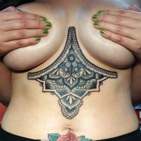 cleavage tattoo 80 breast tattoos that will emphasize your assets