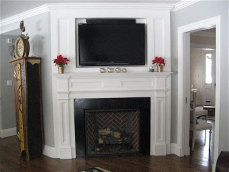 gas fireplaces with televisions above fireplaces