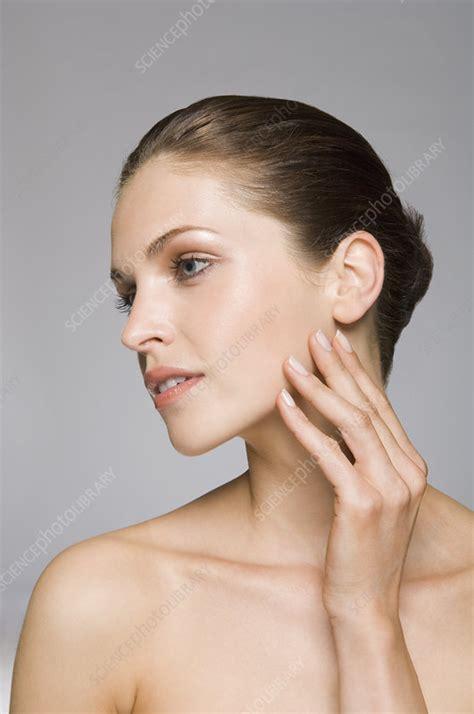Spl Skincare Madiun model touching skin stock image f003 7547