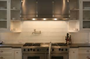 white glass subway tiles transitional kitchen giannetti home