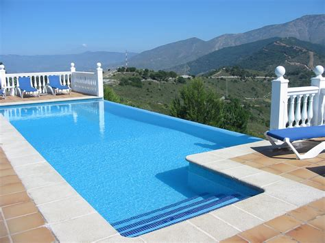 swimming pool luxury villa in spain with infinity edge swimming pool