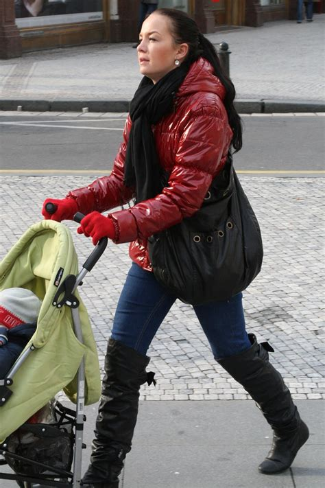 young mother  shiny red jacket  overknee leather boot