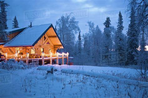 log cabin   woods decorated  christmas lights  twilight  fairbanks alaska