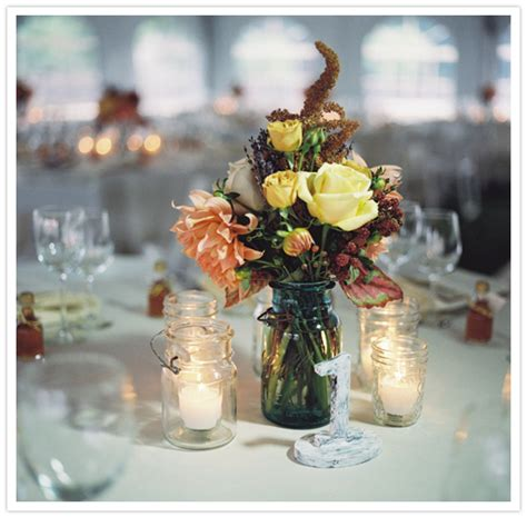 wedding centerpieces with jars and candles newburyport fall wedding larry real weddings 100 layer cake