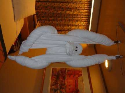 Towel Origami Monkey - how to fold cruise ship towel animals cruise stories