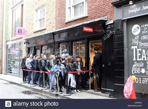 stores that sell supreme supreme shop in soho with queue outside picture