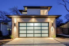 cochera meaning modern garage door cedar soffits dark siding house