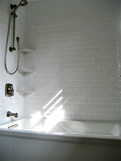 kohler bath shower combo beveled subwau tiles transitional bathroom involving color