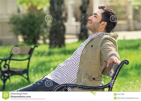 bench manly man sitting and relaxing on bench stock photography