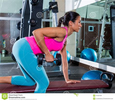 bent over row on bench girl one arm dumbbell bent over row workout stock photo